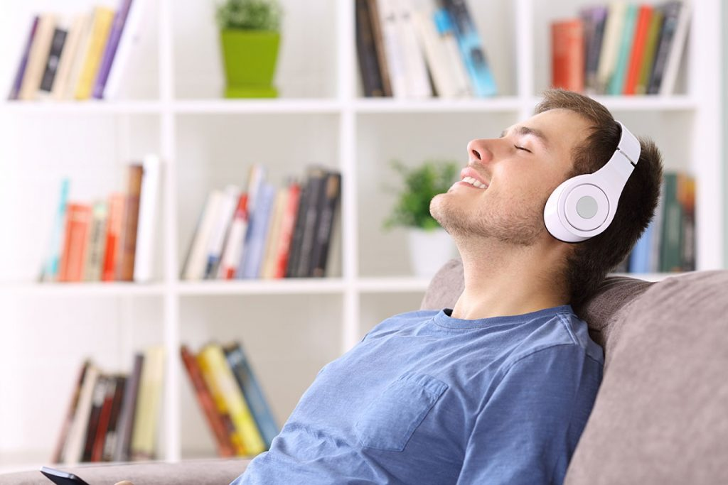 Guy listening to SELFCARE Mindfulness course