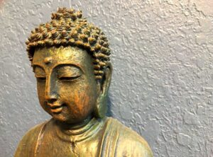 Buddha offering guidance on wholesome living via the Five Mindfulness Trainings. Hellagood Life